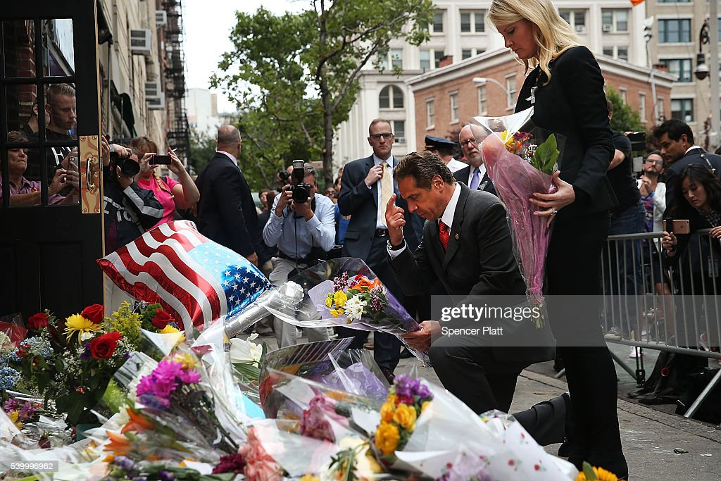New York Governor Andrew Cuomo pauses with his girlfriend Sandra Lee in front of the iconic New York City gay and lesbian bar The Stonewall Inn to lay flowers and grieve for those killed in Orlando on June 13, 2016 in New York City. An American-born man who had recently pledged allegiance to ISIS killed 50 people early Sunday at a gay nightclub in Orlando, Florida. The massacre is the deadliest mass shooting in United States history.