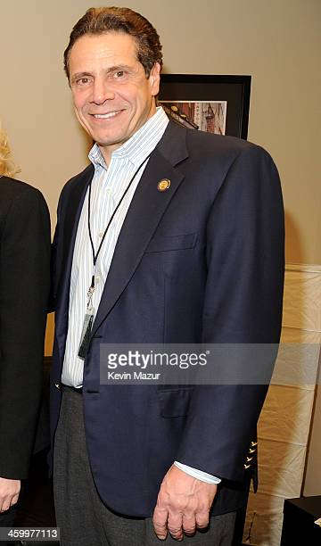 New York Governor Andrew Cuomo poses backstage at the Billy Joel New Year's Eve Concert at the Barclays Center of Brooklyn on December 31 2013 in New...