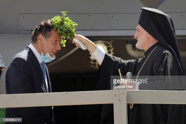 New York Governor Andrew Cuomo receives a blessing from his Eminence Archbishop Elpidophoros of America in a ceremony for the resumption of...