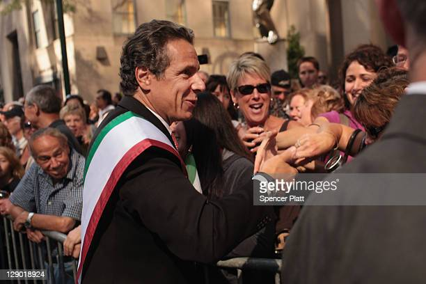 New York Governor Andrew Cuomo shakes hands along the route of the 67th annual Columbus Day Parade on October 10 2011 in New York City The annual...