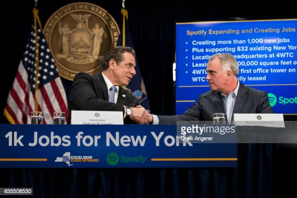 New York Governor Andrew Cuomo shakes hands with Horacio Gutierrez General Counsel for Spotify during a press conference to announce that Spotify...
