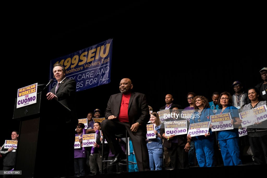 New York Governor Andrew Cuomo speaks as 1199SEIU United Healthcare Workers East President George Gresham looks on at a healthcare union rally at the Theater at Madison Square Garden, February 21, 2018 in New York City. The rally was organized by 1199SEIU United Healthcare Workers East, the largest healthcare union in the United States.