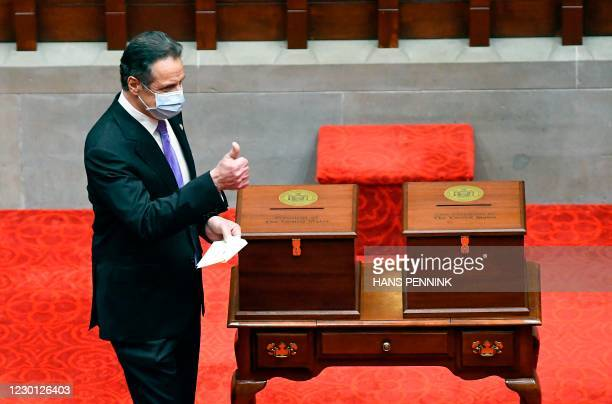 New York Governor Andrew Cuomo speaks to members of New York state's Electoral College before voting for President and Vice President in the Assembly...