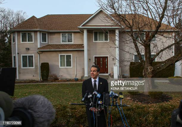 New York Governor Andrew Cuomo speaks to the media outside the home of rabbi Chaim Rottenbergin Monsey in New York on December 29 2019 after a...