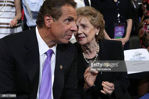 New York Governor Andrew Cuomo speaks with his mother Matilda Cuomo during the Democratic National Convention at the Wells Fargo Center July 28 2016...