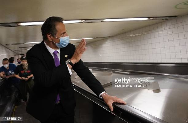 New York Governor Andrew Cuomo takes the escalator after riding the New York City subway 7 train into the city on June 8, 2020 in New York. - Today...