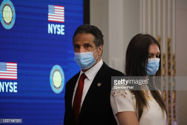 New York Governor Andrew Cuomo walks past his daughter Mariah Kennedy-Cuomo as he holds his daily press briefing at the New York Stock Exchange on...