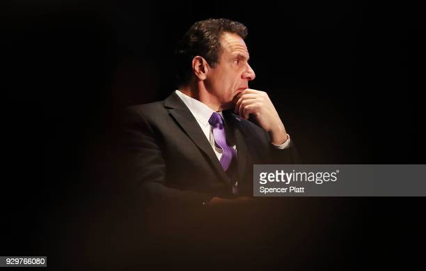 New York Governor Andrew Cuomo watches as former Vice President Al Gore speaks at an event at New York University denouncing the Trump...