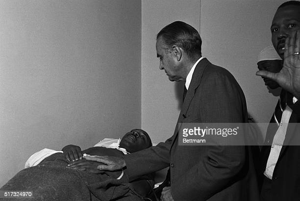 New York Governor Averell Harriman stands at the hospital bed of civil rights leader Dr Martin Luther King Jr after he was stabbed at a book signing...