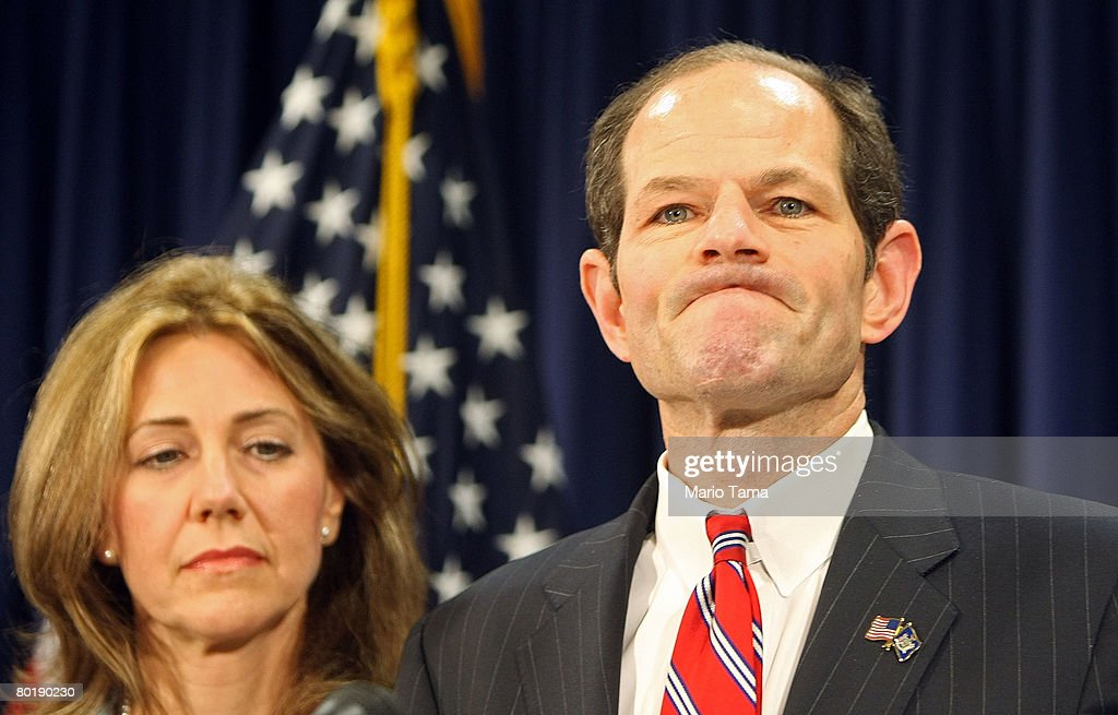 New York Governor Eliot Spitzer speaks to the media with his wife Silda Wall Spitzer while delivering an apology to his family and the public following reported links to a prostitution ring March 10, 2008 in New York City. Spitzer apologized to his family and public during the press conference but did not directly address the reports of his being linked to a prostitution ring.