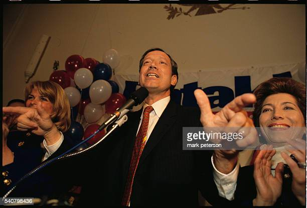 New York Governor George Pataki attends a rally at the National Federation of Republican Women's Club in Manhattan with running mate Betsy McCaughey...