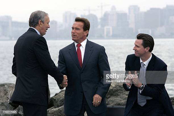 New York Governor George Pataki shakes hands with California Governor Arnold Schwarzenegger and San Francisco Mayor Gavin Newsom on September 27 2006...