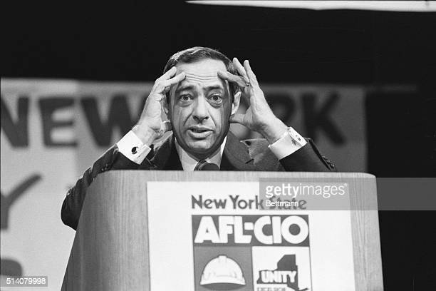 New York Governor Mario Cuomo displays a quizzical expression during an address to the state AFLCIO convention in Albany hands at sides of face Cuomo...