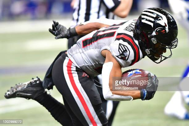 New York Guardians cornerback Anthony Texada II is tripped up as he carries the ball during an XFL game between the New York Guardians and the St...