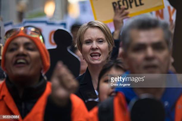 New York gubernatorial candidate Cynthia Nixon marches with activists as they rally against financial institutions' support of private prisons and...