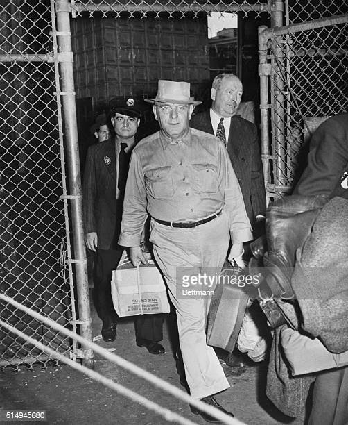 His Work over Carrying suitcase and cardboard box Fritz Kuhn former GermanAmerican Bund leader enters the docks today just before he boarded the ship...