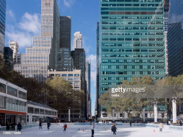 New York ice rink at Bryant Park with the skyline in the background