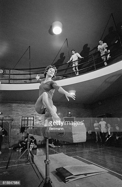 In Form Russia's Larisa Latynina an Olympic gold medal winner in the allaround and free exercise gymnastic event displays her form on the balance bar...
