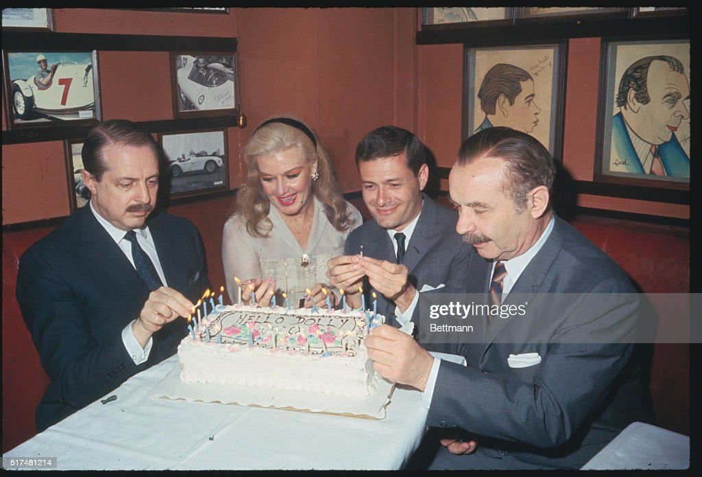 In Sardi's restaurant celebrating the 1,000th performance of the Broadway hit, Hello, Dolly, are, left to right, producer David Merrick; star Ginger Rogers; composer-lyricist Jerry Herman and David Burns, costar of the musical.