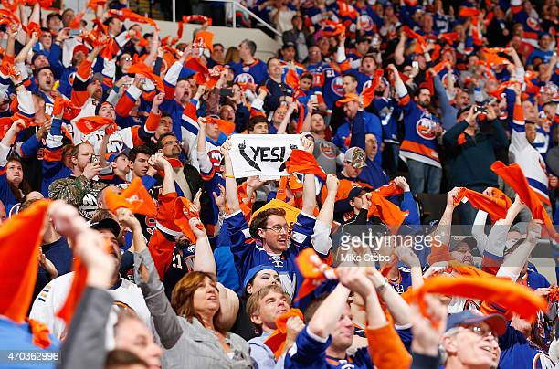 New York Islander fans cheer for their team during the game against the Washington Capitals during Game Three of the Eastern Conference Quarterfinals...