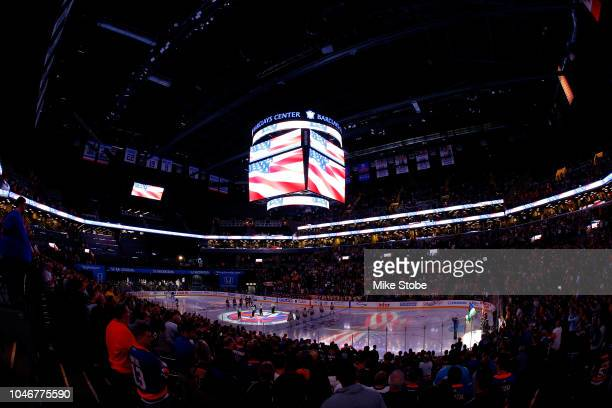 New York Islanders and Nashville Predators stand during the National Anthem at Barclays Center on October 6 2018 the Brooklyn borough of New York City