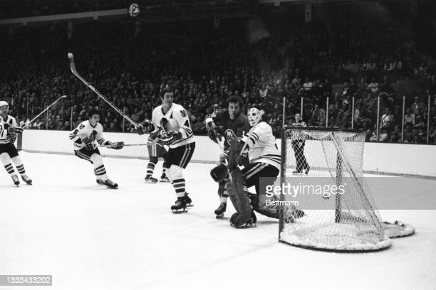 New York Islanders' Billy MacMillan runs into Chicago Blackhawks' goalie Tony Esposito as he scores goal in the first period of the game.