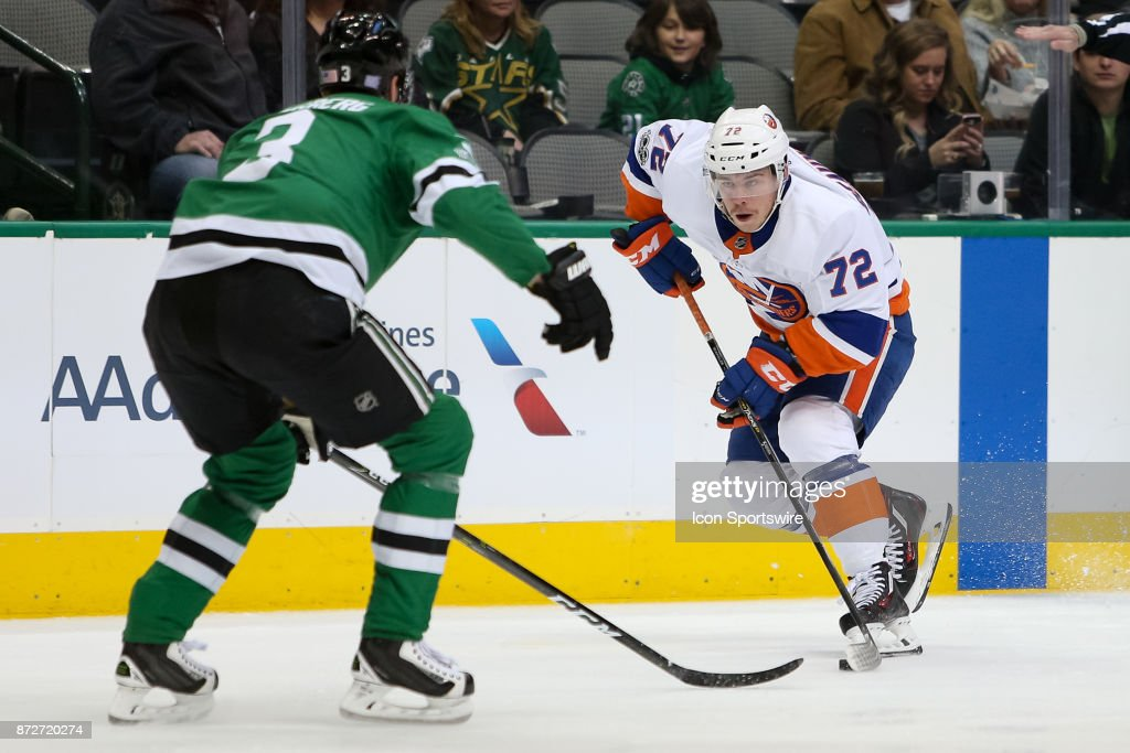 New York Islanders Center Anthony Beauvillier (72) brings the puck across the blue line with Dallas Stars Defenceman John Klingberg (3) defending during the NHL hockey game between the New York Islanders and Dallas Stars on November 10, 2017 at American Airlines Center in Dallas, TX.