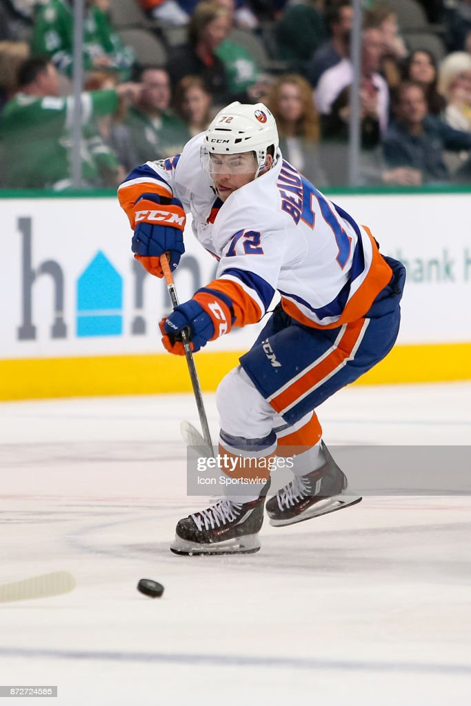 New York Islanders Center Anthony Beauvillier (72) plays the puck across the blue line during the NHL hockey game between the New York Islanders and Dallas Stars on November 10, 2017 at American Airlines Center in Dallas, TX.