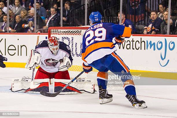 New York Islanders Center Brock Nelson sends the puck right into the chest of Columbus Blue Jackets Goalie Sergei Bobrovsky during the second period...