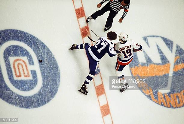 New York Islanders' center Bryan Trottier wins a faceoff against the Toronto Maple Leafs' Darryl Sittler during the Stanley Cup Playoffs at Nassau...