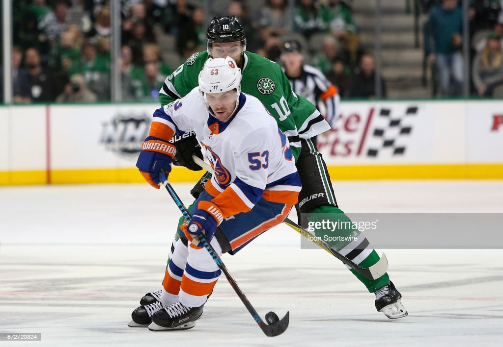 New York Islanders Center Casey Cizikas (53) handles the puck while being pursued by Dallas Stars Center Martin Hanzal (10) during the NHL hockey game between the New York Islanders and Dallas Stars on November 10, 2017 at American Airlines Center in Dallas, TX.