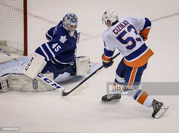 New York Islanders center Casey Cizikas scores on a breakaway late in the 2nd period on Toronto Maple Leafs goalie Jonathan Bernier to make it 2-1...