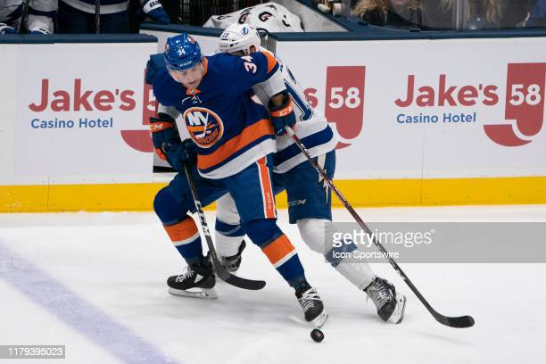 New York Islanders Center Cole Bardreau and Tampa Bay Lightning Center Cedric Paquette battle for the puck during the second period of the National...