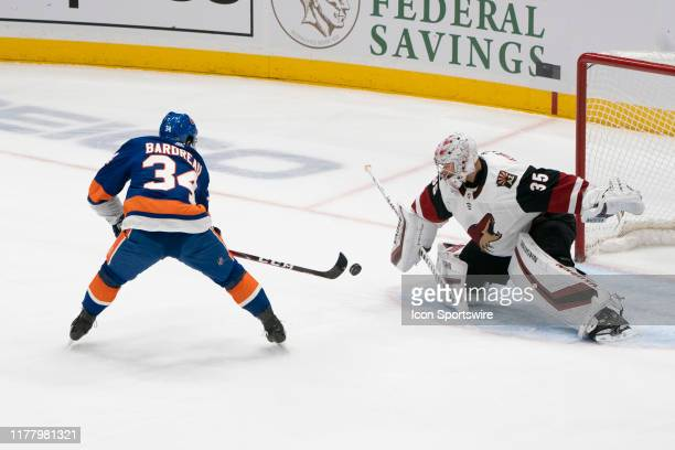 New York Islanders Center Cole Bardreau takes a shot on Arizonia Coyotes Goalie Darcy Kuemper during the first period of the National Hockey Le3ague...