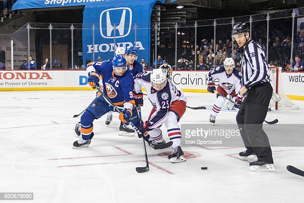 New York Islanders Center John Tavares and Columbus Blue Jackets Center William Karlsson face off in the Islanders zone during the second period of a...