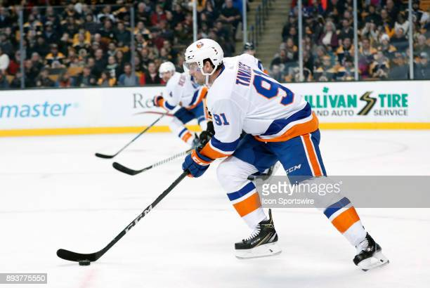 New York Islanders center John Tavares skates up ice during a game between the Boston Bruins and the New York Islanders on December 9 at TD Garden in...