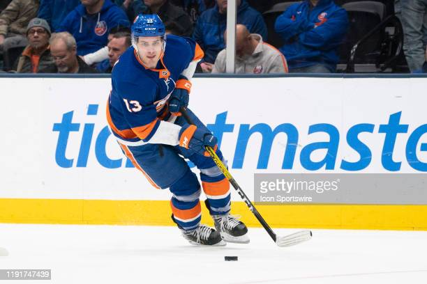 New York Islanders Center Mathew Barzal skates with the puck during the first period of the National Hockey League game between the New Jersey Devils...