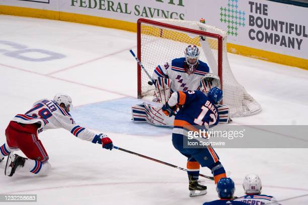 New York Islanders Center Mathew Barzal takes a shot on New York Rangers Goalie Igor Shesterkin defending the goal during the third period of the...