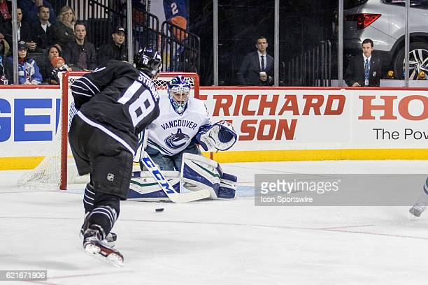 New York Islanders Center Ryan Strome shoots the puck right at Vancouver Canucks Goalie Ryan Miller during the second period a regular season NHL...