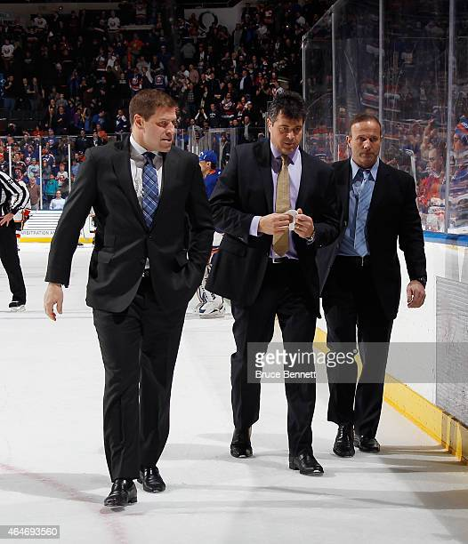 New York Islanders coaches Doug Weight Jack Capuano and Greg Cronin leave the ice following a 21 victory over the Calgary Flames at the Nassau...