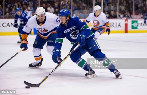 New York Islanders Defenceman Adam Pelech attempts to check Vancouver Canucks Right Wing Jake Virtanen during the second period in a NHL hockey game...