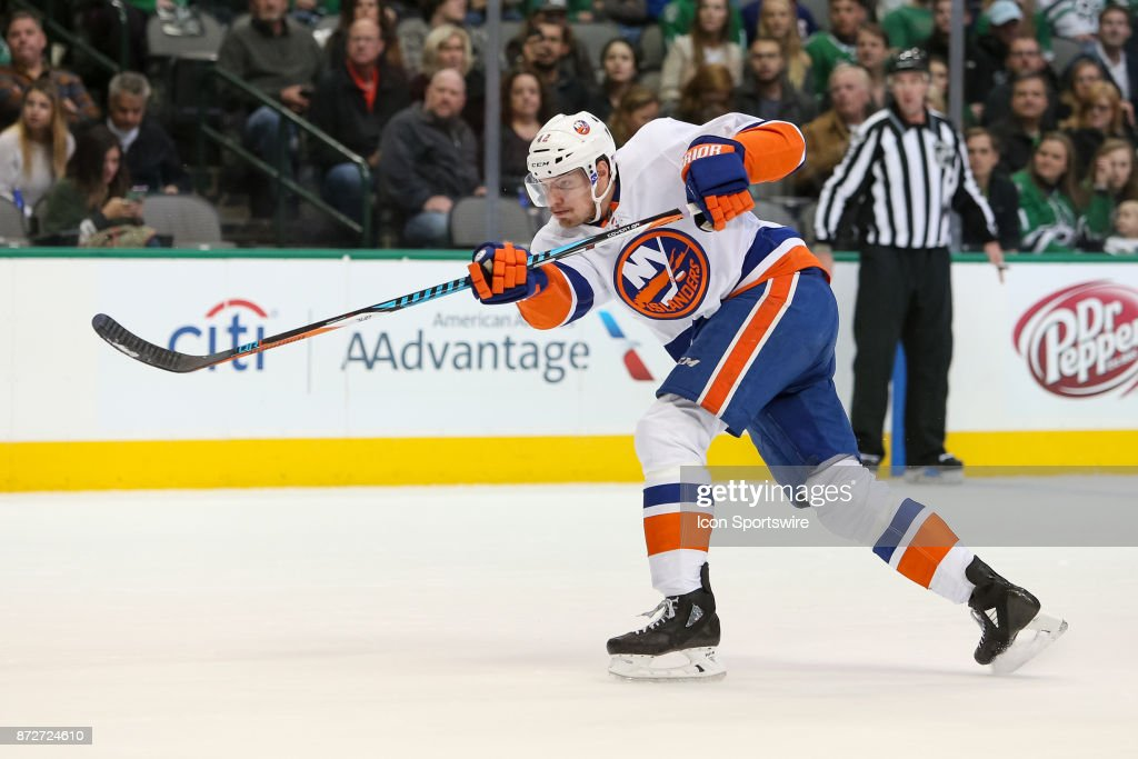 New York Islanders Defenceman Scott Mayfield (42) shoots during the NHL hockey game between the New York Islanders and Dallas Stars on November 10, 2017 at American Airlines Center in Dallas, TX.