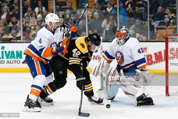New York Islanders defenseman Dennis Seidenberg does enough to stop Boston Bruins center David Backes in front of New York Islanders goalie Jaroslav...