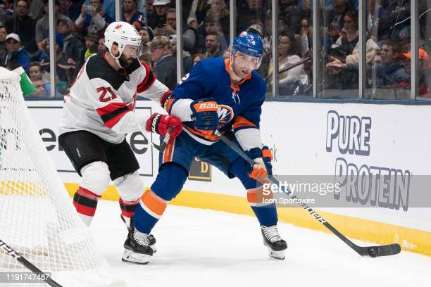 New York Islanders Defenseman Nick Leddy skates with the puck with New Jersey Devils Right Wing Kyle Palmieri defending during the second period of...