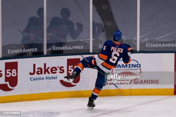 New York Islanders Defenseman Ryan Pulock reacts to scoring the winning goal during the overtime period of the National Hockey League game between...