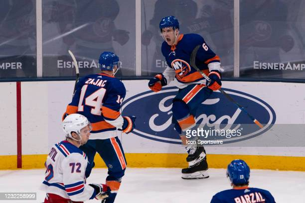 New York Islanders Defenseman Ryan Pulock reacts to scoring the winning goal along with New York Islanders Center Travis Zajac during the overtime...