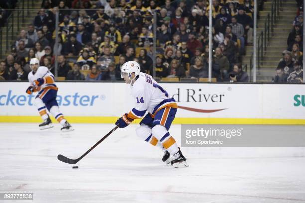 New York Islanders defenseman Thomas Hickey skates up ice with the puck during a game between the Boston Bruins and the New York Islanders on...