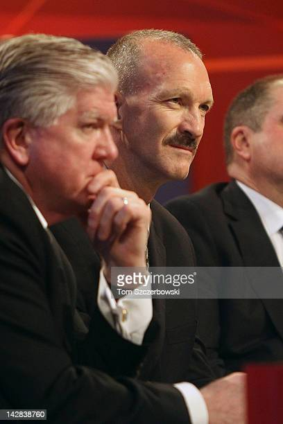 New York Islanders Director of Pro Scouting Ken Morrow looks on next to Toronto Maple Leafs General Manager Brian Burke at the NHL Draft Lottery on...