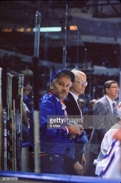 New York Islanders equipment manager Jim Pickard stands next to hockey sticks behind the bench during a game at Nassau Coliseum Uniondale Long Island...