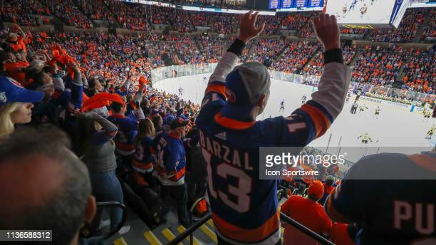 New York Islanders fans are energetic after the go-ahead goal during game 2 of the first round of the Stanley Cup Playoffs between the New York...
